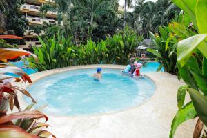 The swimming pool at or close to Paradise Garden Resort Hotel & Convention Center