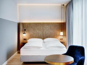 Ein Bett oder Betten in einem Zimmer der Unterkunft STAGE 12 Hotel by Penz