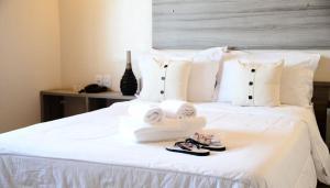 Cama ou camas em um quarto em Hotel Do Forte