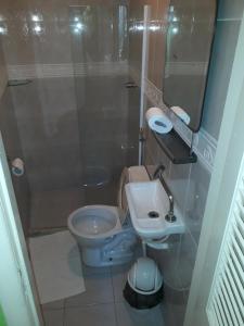 Um banheiro em Hotel Pousada Papaya Verde
