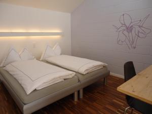 Кровать или кровати в номере Hotel Alte Gärtnerei