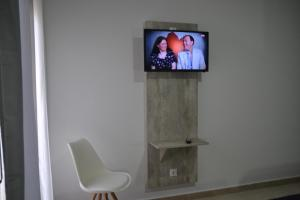 A television and/or entertainment centre at Hotel Congra