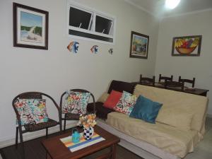Uma área de estar em Apartamento Costa Nova