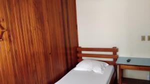 A bed or beds in a room at Hotel Ximenes