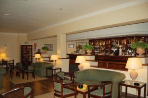 The lounge or bar area at Hotel Jardim