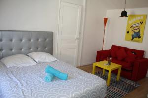 A bed or beds in a room at Casa Ammirati Apartments