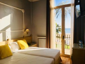 Hotel Celimarにあるベッド