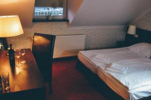 Łóżko lub łóżka w pokoju w obiekcie Pyszna Stajenka