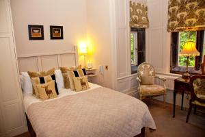 A bed or beds in a room at Whitley Hall Hotel