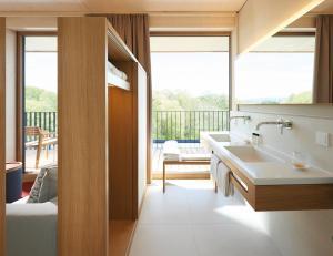 Ein Badezimmer in der Unterkunft Hotel Bora HotSpaResort