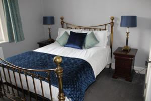 A bed or beds in a room at Dower House Hotel