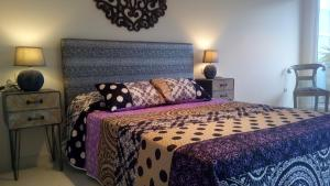 A bed or beds in a room at La Bohemia Altea Hills