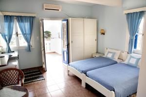 Кровать или кровати в номере Themelina Studios