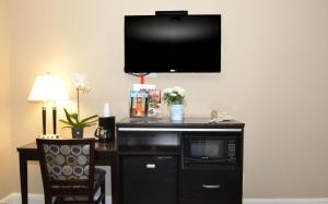 A television and/or entertainment center at Executive Inn