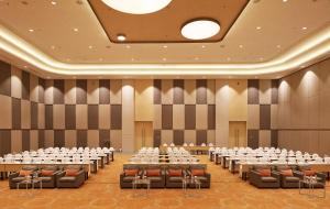 A restaurant or other place to eat at HARRIS Hotel & Conventions Bekasi