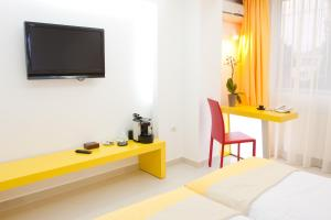 A television and/or entertainment center at Christina Hotel