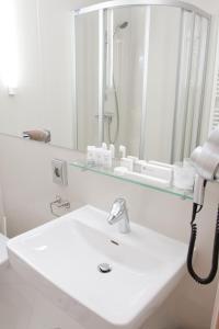 A bathroom at Christina Hotel