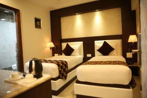 A bed or beds in a room at Kc Inn