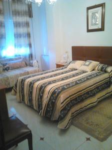 A bed or beds in a room at Apartamento en Sardiñeiro