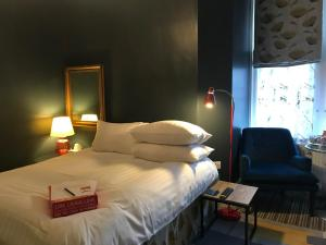 A bed or beds in a room at Regency Rooms
