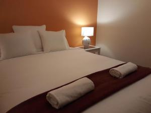 A bed or beds in a room at Stay @Airport