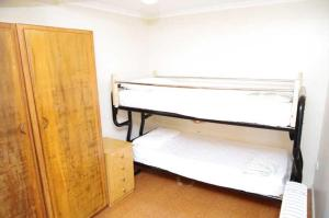 A bunk bed or bunk beds in a room at Beachfront 5, 25 Willow Street