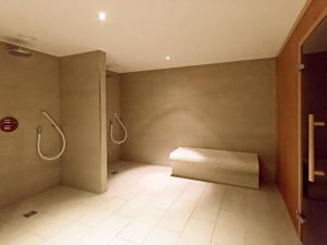 A bathroom at DORMERO Hotel Altes Kaufhaus