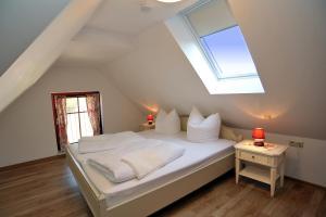 Ein Bett oder Betten in einem Zimmer der Unterkunft Villa Rosamunde
