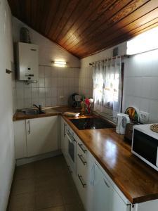 Cuisine ou kitchenette dans l'établissement Apartments Finca El Rincón