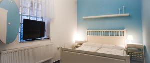 Postel nebo postele na pokoji v ubytování Herbenka