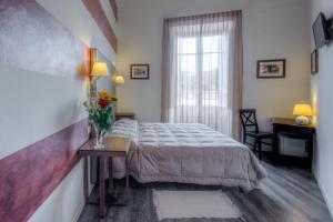Letto o letti in una camera di Al Bastione di Cagliari