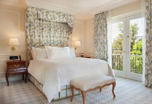 A bed or beds in a room at The Peninsula Beverly Hills