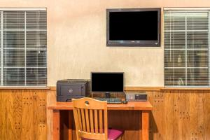 A television and/or entertainment center at Super 8 by Wyndham Wickenburg AZ