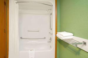 A bathroom at Super 8 by Wyndham Denver Stapleton