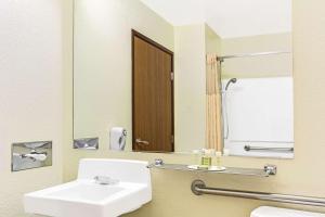 A bathroom at Super 8 by Wyndham Parker/SE Denver Area
