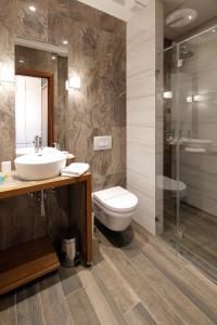 A bathroom at Hotel Passpartù Home Garni