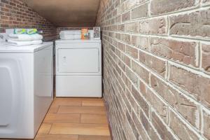 A kitchen or kitchenette at Super 8 by Wyndham Kingston