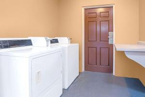 A kitchen or kitchenette at Knights Inn Kissimmee