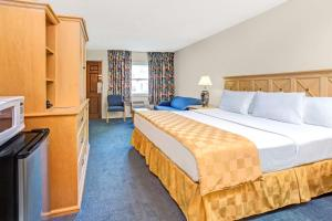 A bed or beds in a room at Knights Inn Kissimmee