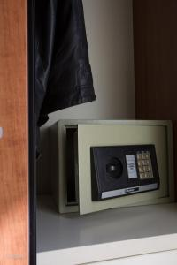 A television and/or entertainment center at Hotel Narcisi