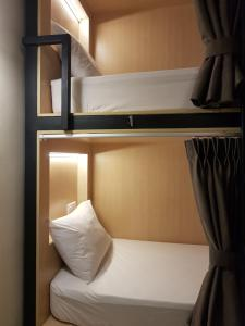 A bunk bed or bunk beds in a room at Hotel 1000 Miles