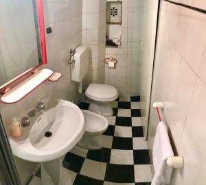 Un baño de Residenza Novella & Giotto - Visitaflorencia
