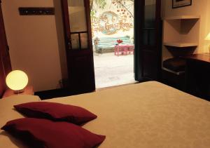 A bed or beds in a room at Lina's Tango Guesthouse