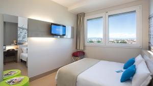 Cama ou camas em um quarto em B&B Hotel Milano Cenisio Garibaldi