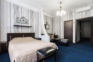 Кровать или кровати в номере Гостевой дом Аллюрия на Мытнинской