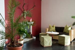 Ein Sitzbereich in der Unterkunft Hotel Berlin - GreenLine Hotel