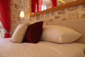 Letto o letti in una camera di Villa Sigurata
