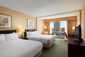 A bed or beds in a room at University Plaza Hotel