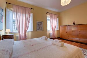 A bed or beds in a room at Residenza Brasca - Visitaflorencia