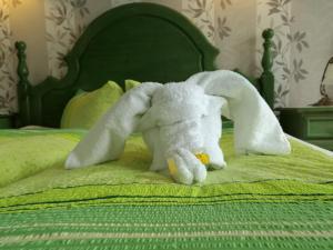 Ein Bett oder Betten in einem Zimmer der Unterkunft Hotel Villa Alice